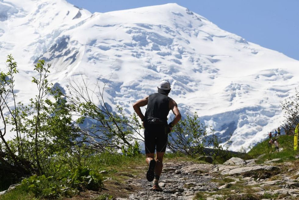 A participant competes during the 16th edition of the Marathon of Mont-Blanc, on July 1, 2018, in Chamonix. (Photo by Jean-Pierre Clatot/AFP/Getty Images)