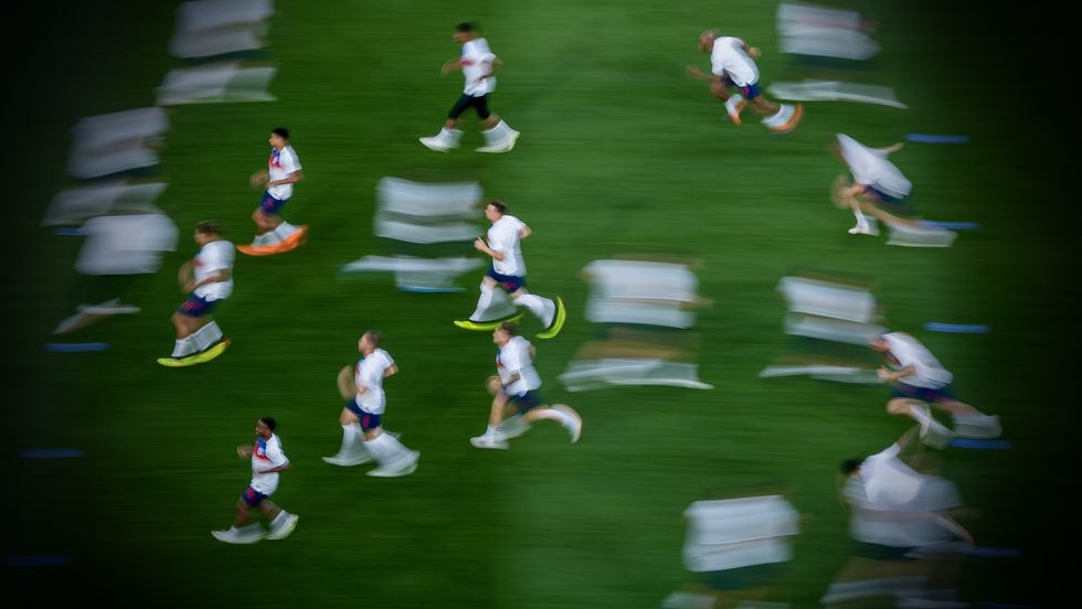 The English players warm up prior to the 2018 FIFA World Cup Russia group G match between England and Belgium (Photo by Matthias Hangst/Getty Images)