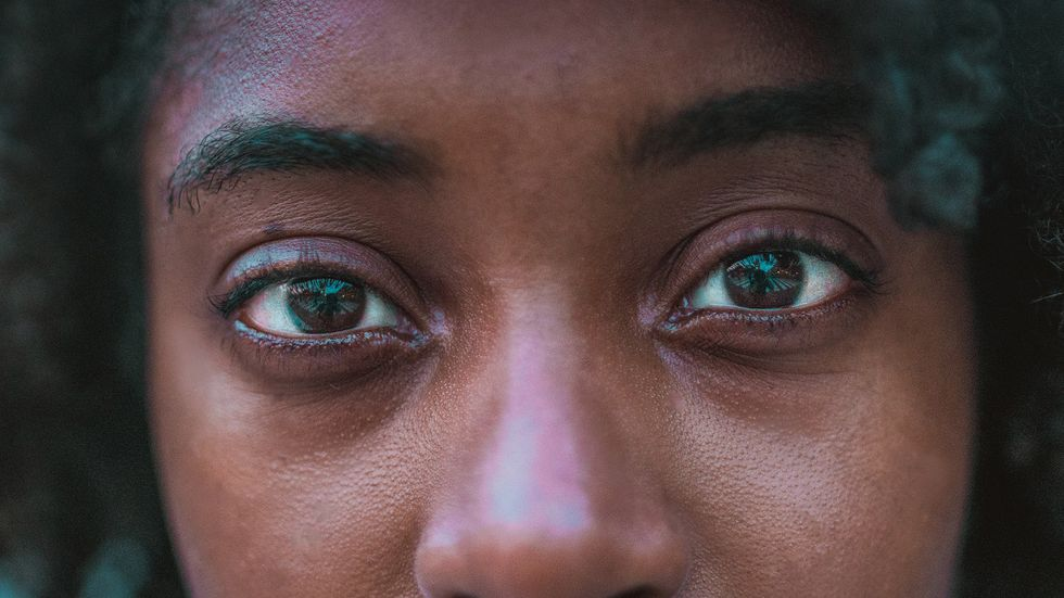 A woman's intense gaze stare with eye contact close up (Photo by Jezael Melgoza on Unsplash)
