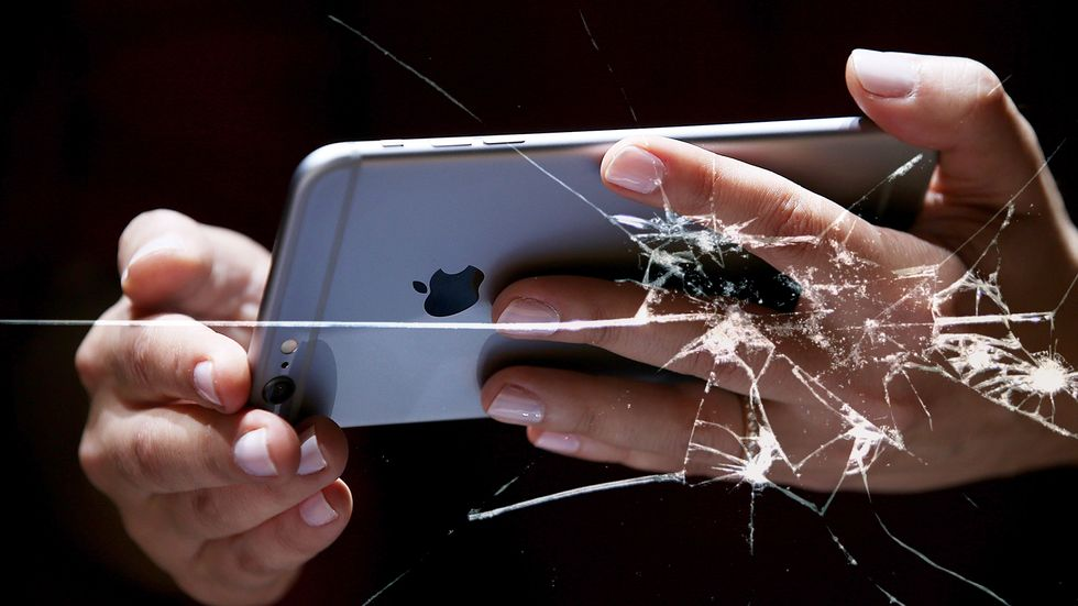 Apple iPhone cracked screen. Nearly every stage in the smartphone life cycle involves something ethically questionable. (Photo by Justin Sullivan/Getty Images)