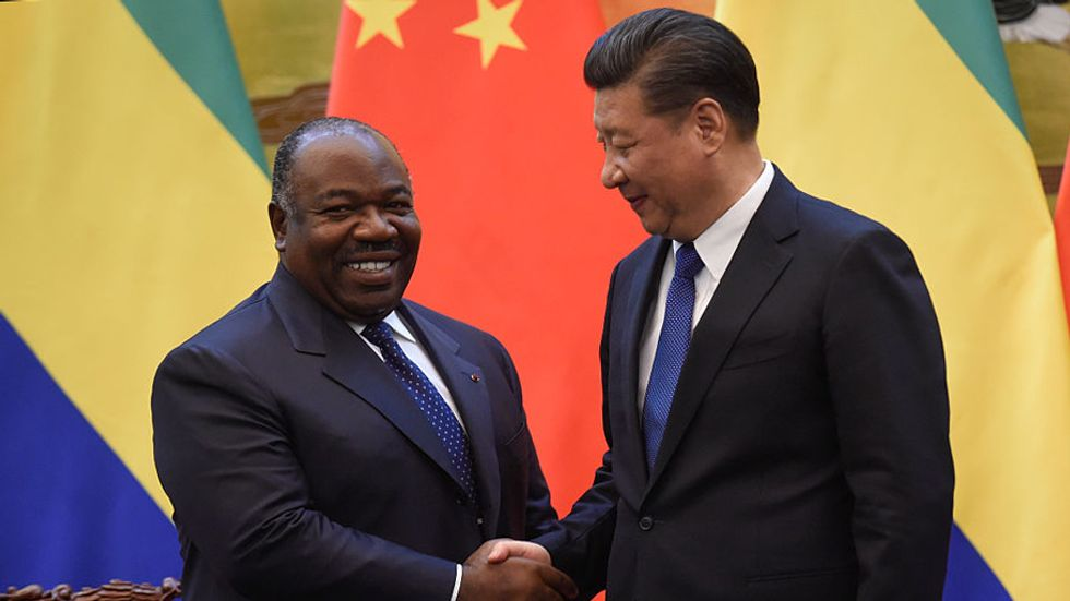 Chinese President Xi Jinping (R) shakes hand of Gabon's President Ali Bongo Ondimba after Gabonese and Chinese delegates signed economic contracts at the Great Hall of the People on December 7, 2016 in Beijing, China. (Photo: Fred Dufour - Pool /Getty Ima