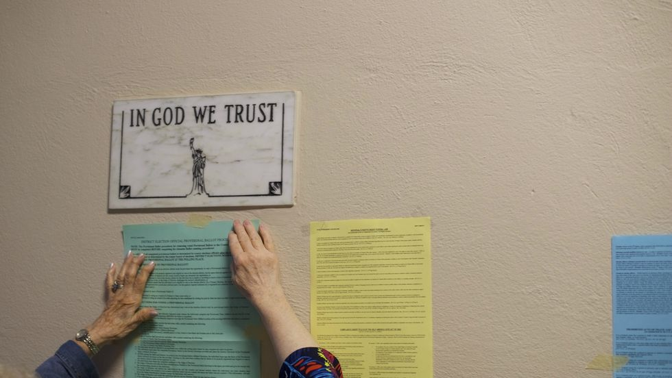 'In God We Trust' sign in a public school. Photo: Mark Makela/Getty Images