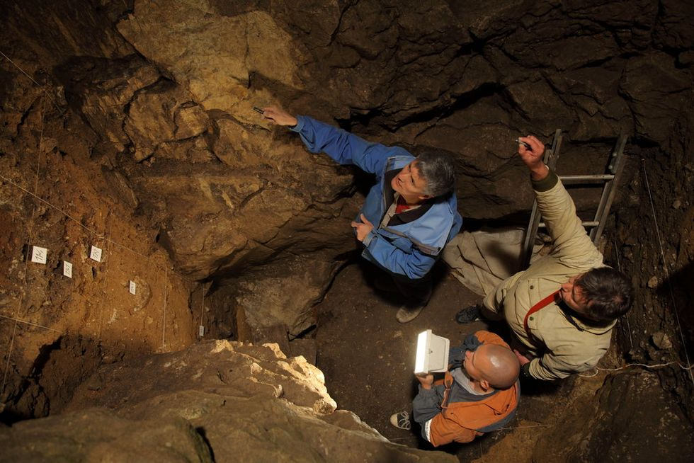 Researchers in a chamber of the Denisova cave in Siberia, where the fossil of a Denisova 11 was discovered. CreditIAET SB RAS, Sergei Zelensky