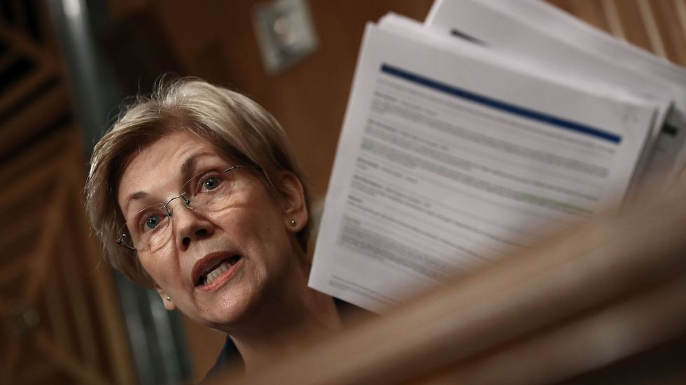Sen. Elizabeth Warren (D-MA) questions John Stumpf, chairman and CEO of the Wells Fargo & Company, during a hearing of the Senate Banking, Housing and Urban Affairs Committee September 20, 2016 in Washington, DC.  (Photo by Win McNamee/Getty Images)