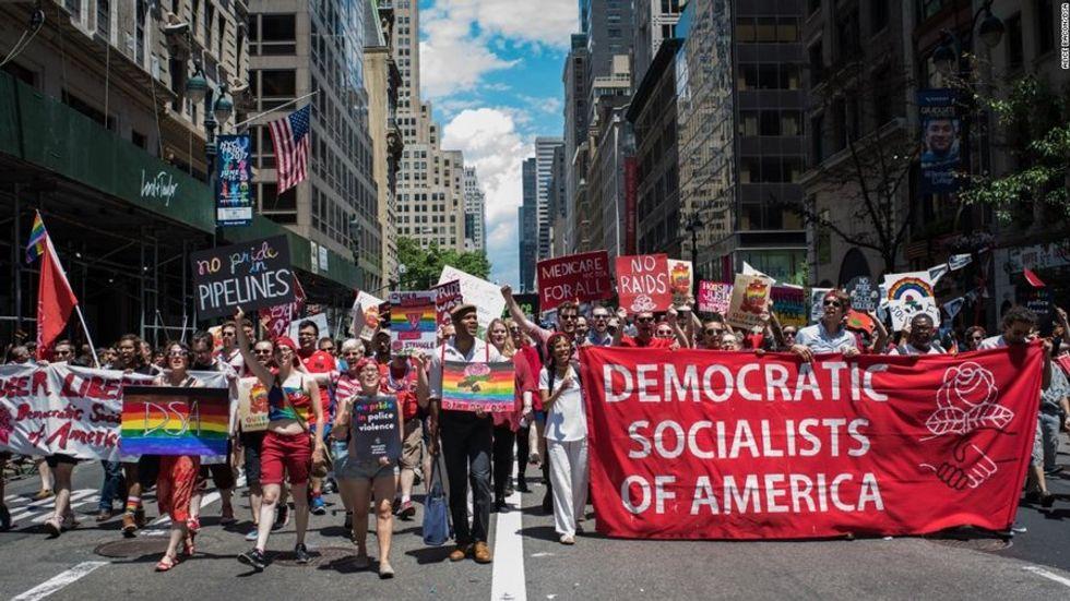 a pride parade featuring a Democratic Socialists of America (DSA) sign