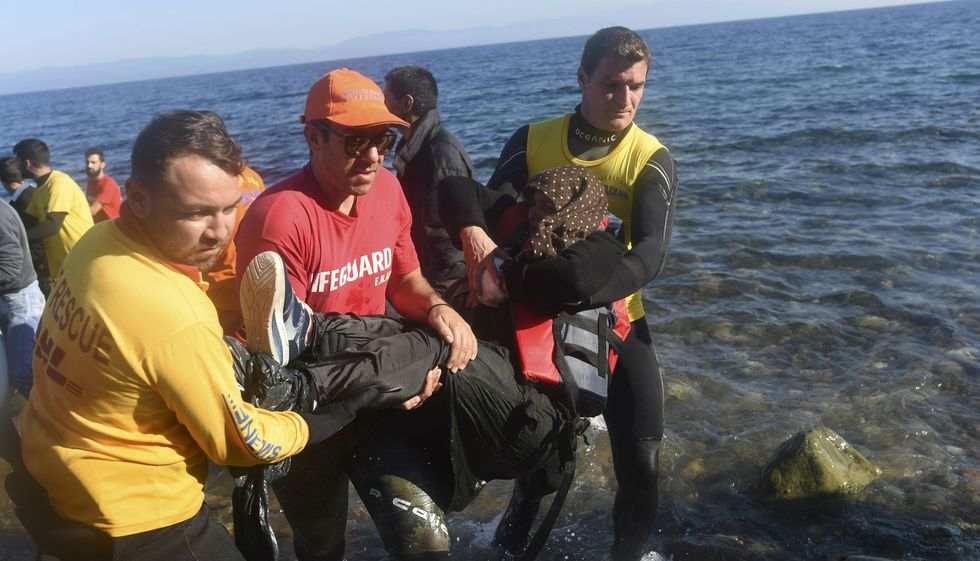 An act of true altruism? Lifeguards pull a migrant woman from the sea