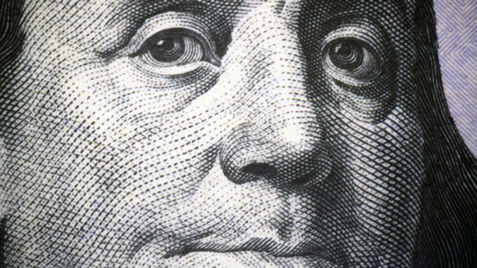 A close up of Benjamin Franklin as he is featured on the one hundred dollar bill (Shutterstock).