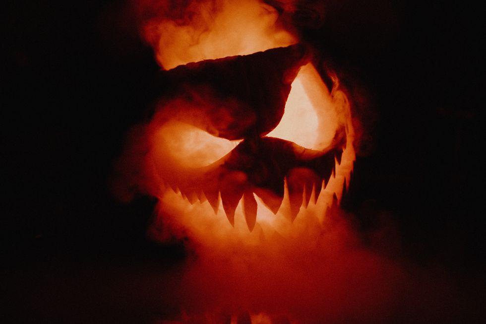 Carved pumpkin with smoke inside