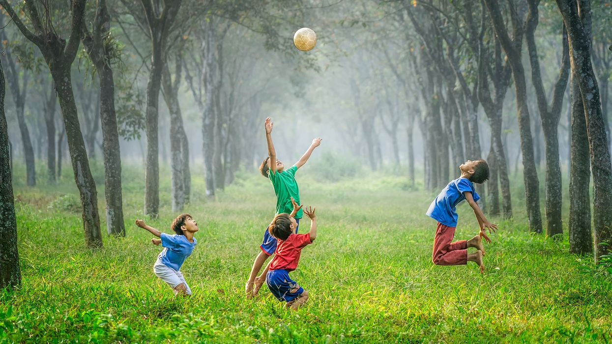 Kids playing with ball in forest