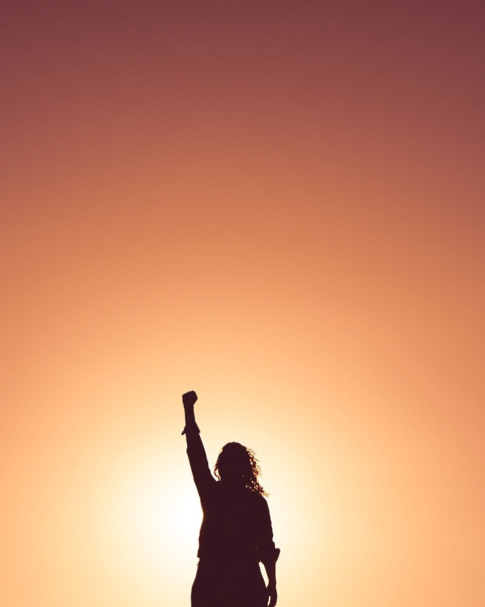 Woman raising her fist to the sky