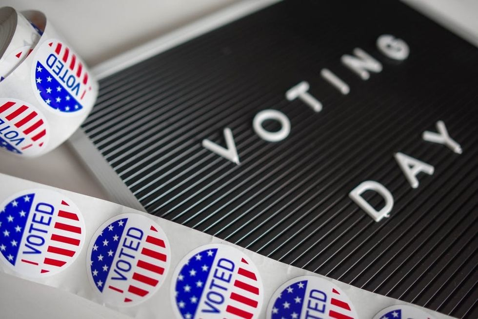 https://www.pexels.com/photo/i-voted-sticker-lot-1550340/