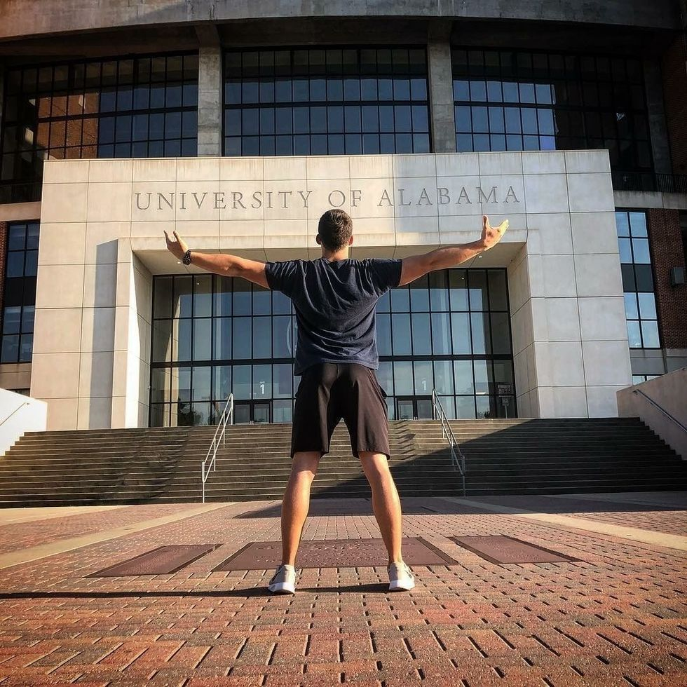 student standing in front of Bryant-Denny stadium in Alabama