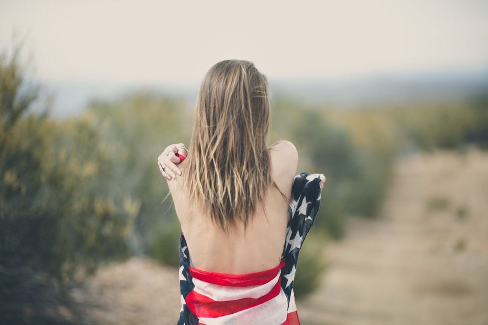 https://www.pexels.com/photo/woman-strapping-her-body-of-american-flag-113709/