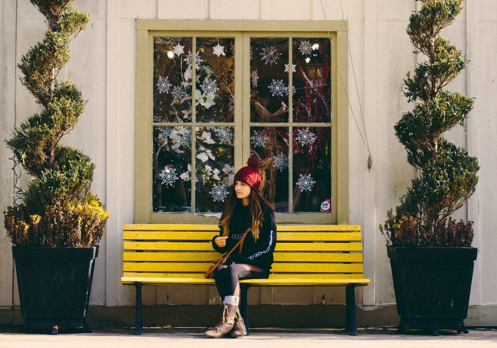 https://www.pexels.com/photo/woman-sitting-on-yellow-bench-1557263/