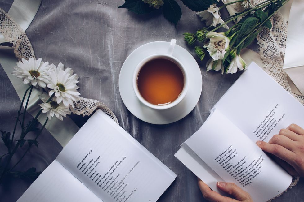 https://www.pexels.com/photo/white-ceramic-teacup-with-saucer-near-two-books-above-gray-floral-textile-904616/