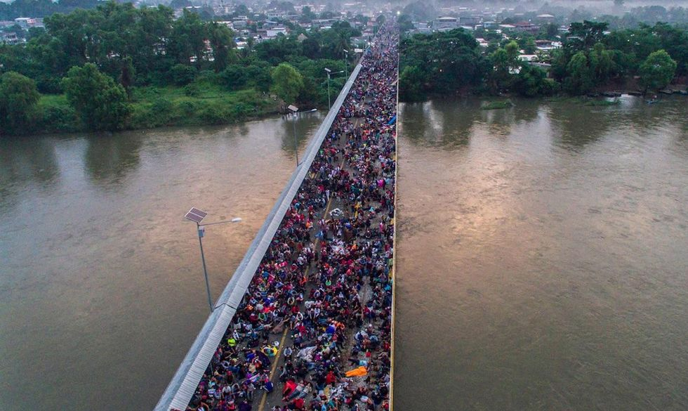 Standoff overnight at Mexico's southern border as migrant caravan of thousands tries to reach US