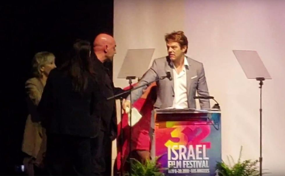 Producer booed for anti-Trump remarks at Israel Film Festival; actor tries pulling him off stage