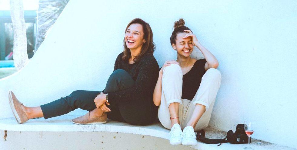https://www.pexels.com/photo/two-women-sitting-on-white-bench-1549280/