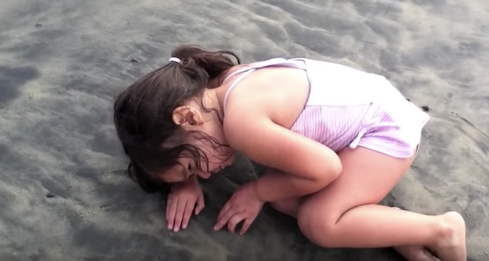 Little Girl Deciding To Nap On The Sand