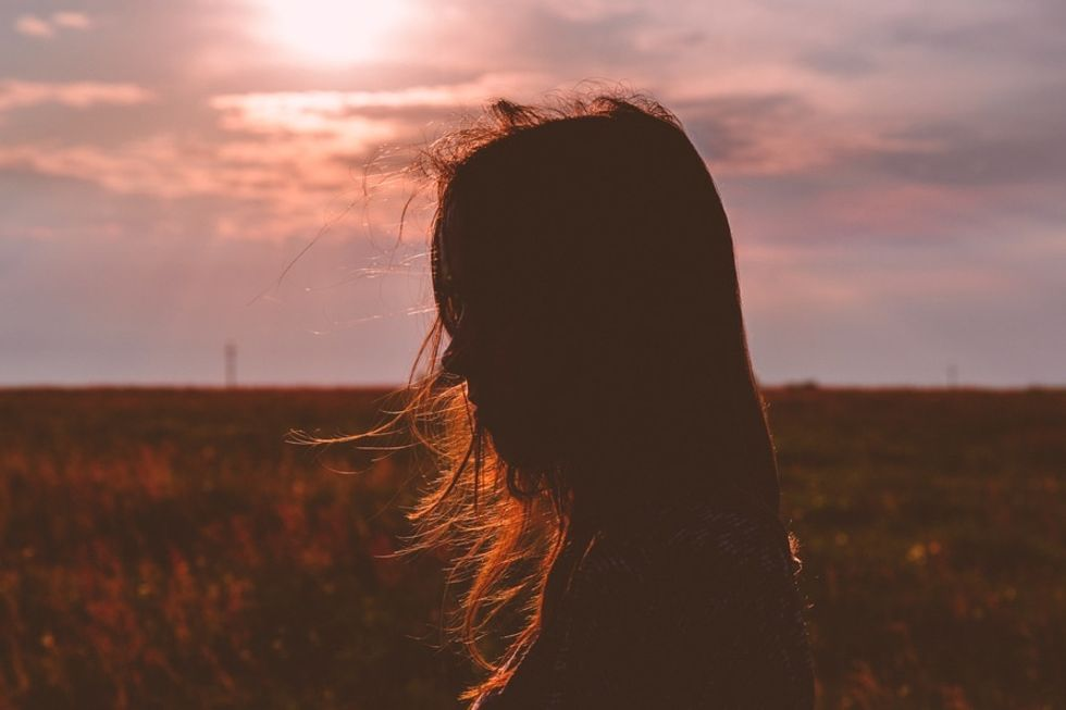 https://www.pexels.com/photo/woman-s-silhouette-photo-during-sunset-185517/