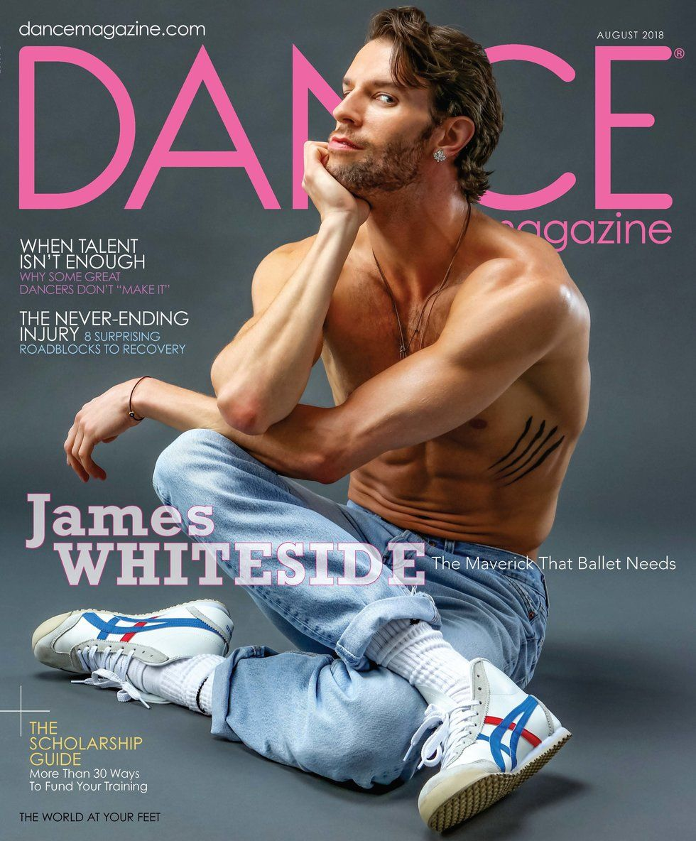 Dance Magazine's August cover featuring a bare-chested James Whiteside in jeans, with a sly side-eyed smirk