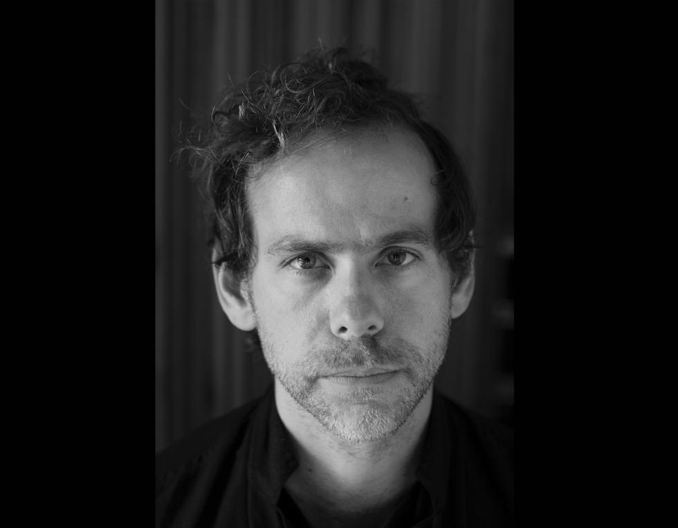 Black and white headshot of guitarist Bryce Dessner
