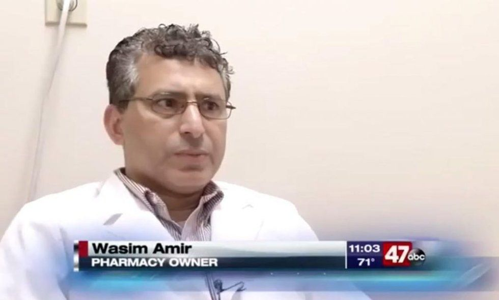 Armed men enter pharmacy, order employees to put their hands