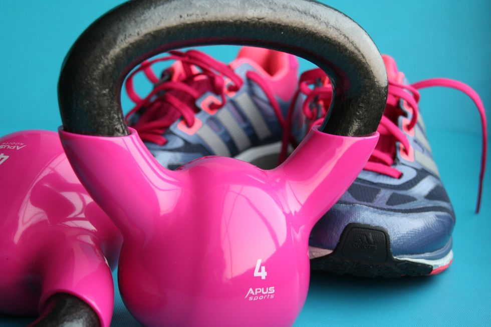 https://www.pexels.com/photo/kettle-bell-beside-adidas-pair-of-shoes-209968/