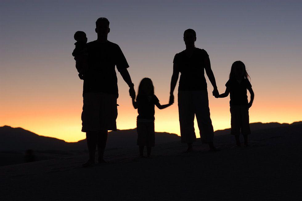 family on hillside