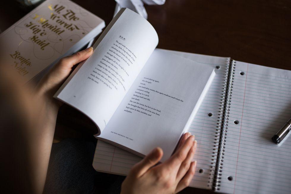 Open Book, Hands, Notebook, and Pen