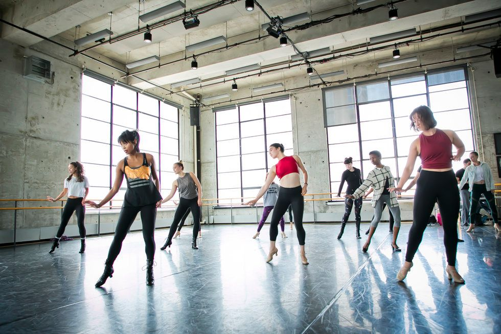 A classroom full of dancers in heels slide to the side
