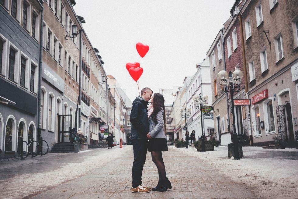 https://www.pexels.com/photo/couple-walking-on-city-street-307791/