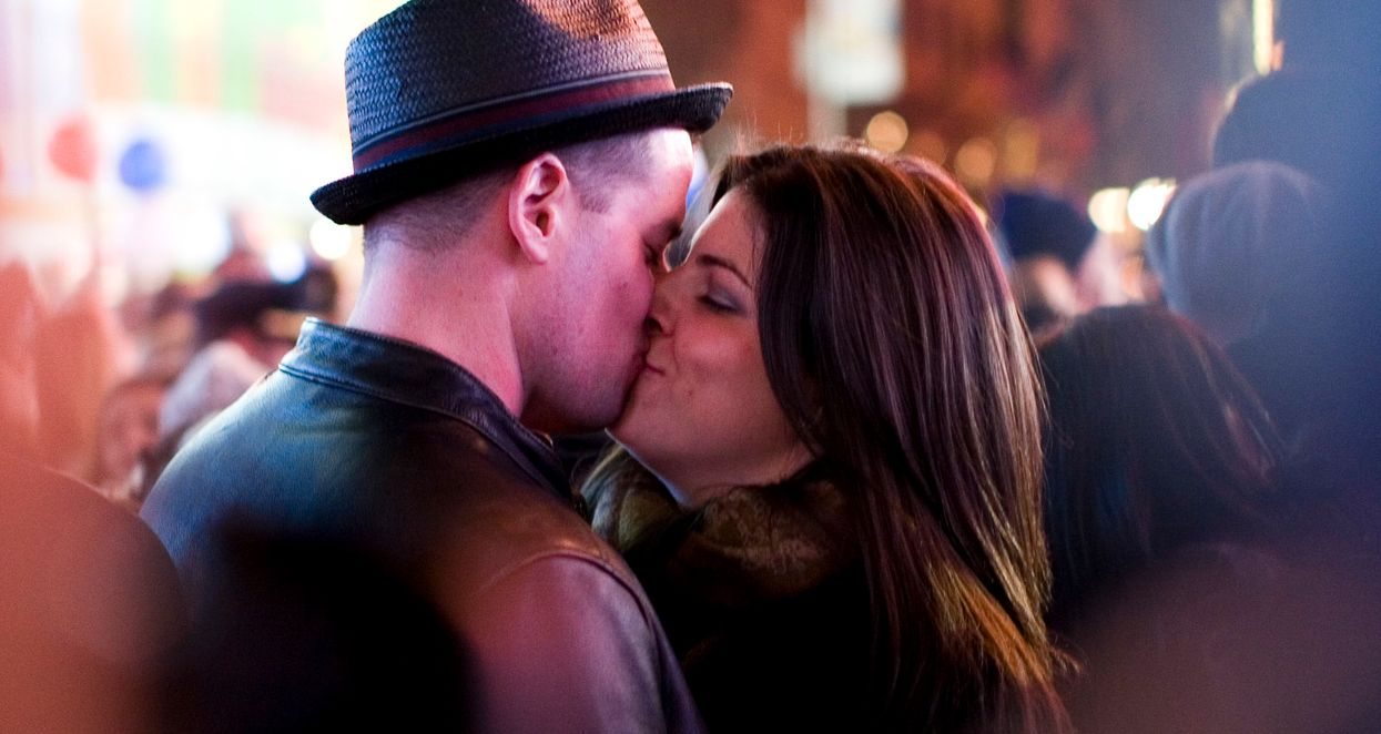 Couple kissing in public.