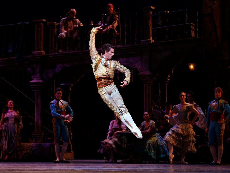 James Whiteside leaps across the stage with his legs together in a bris\u00e9