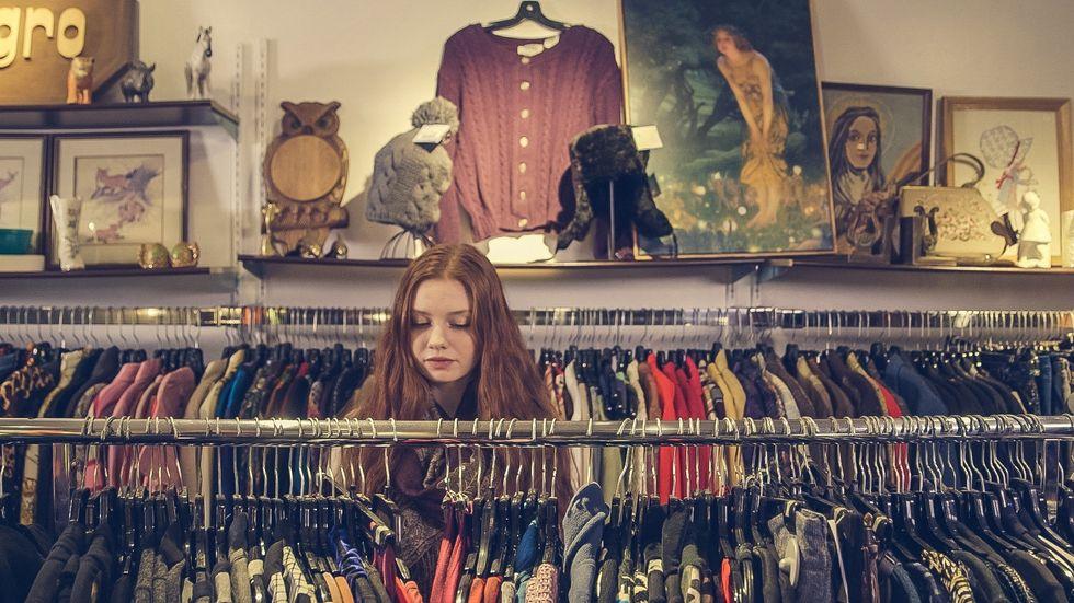 https://www.pexels.com/photo/photo-of-woman-near-clothes-374677/