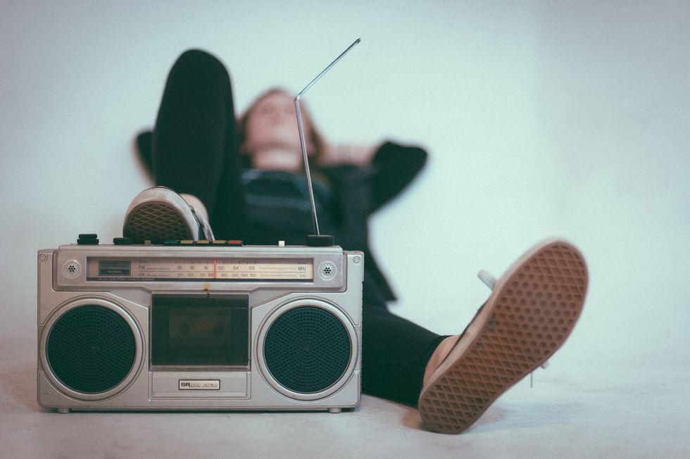 girl with foot on stereo