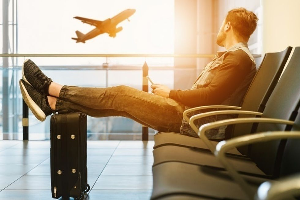 11 Perfect Songs For Any Airport Playlist