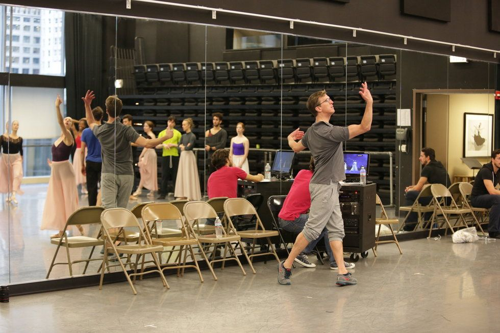 Wheater demonstrates a ballet step during rehearsal.