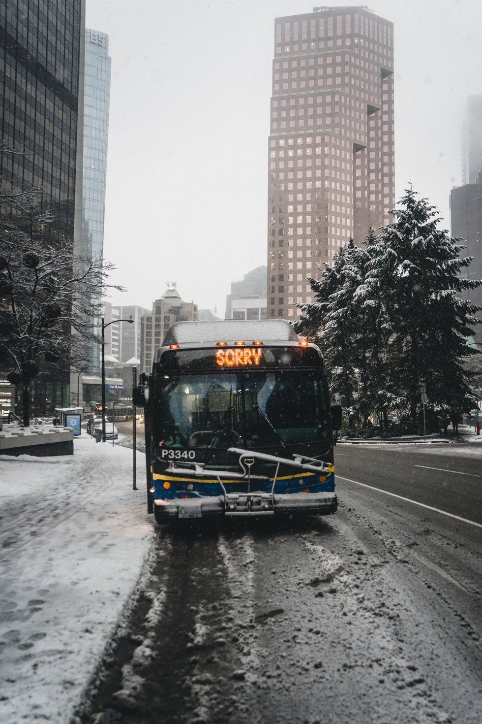 Bus in a cityscape with the word sorry on its destination sign.