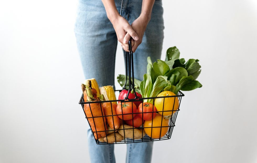https://www.pexels.com/photo/woman-carrying-basket-of-fruits-and-vegetables-1389103/