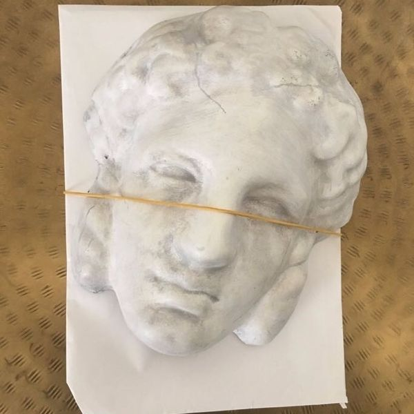 Gucci Sent out Giant Plaster Heads as Invites