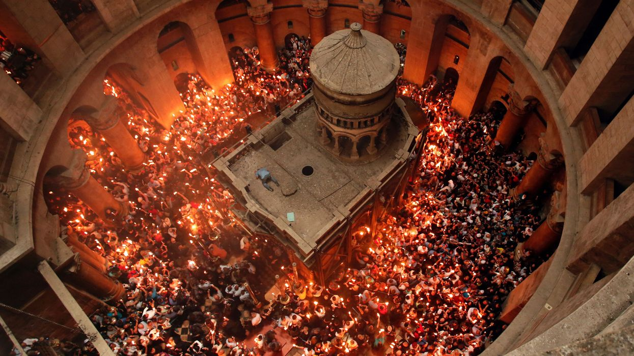 Holy Fire ceremony at Church of the Holy Sepulchre in Jerusalem. Photo: Getty Images.