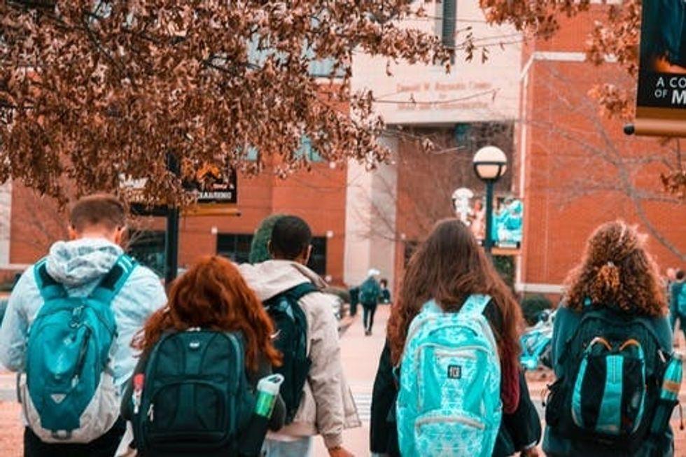 https://www.pexels.com/photo/people-wearing-backpacks-1454360/