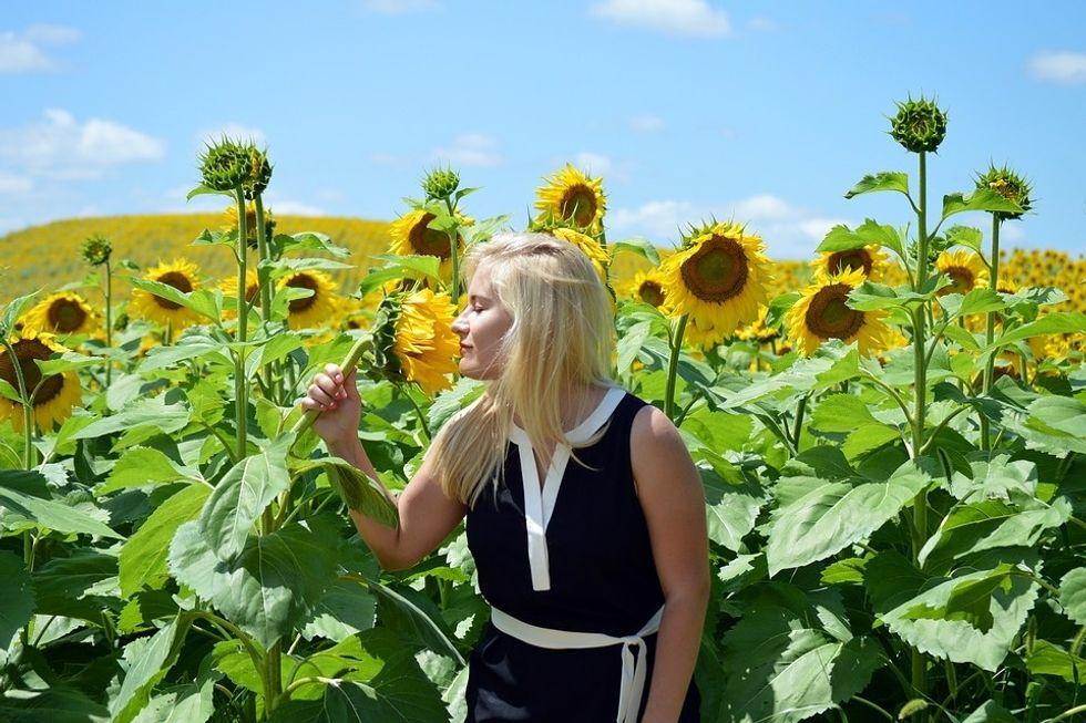 girl in sunflower field summertime