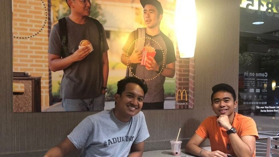Two teens who secretly hung fake McDonald's poster for 51 days are getting a huge reward.