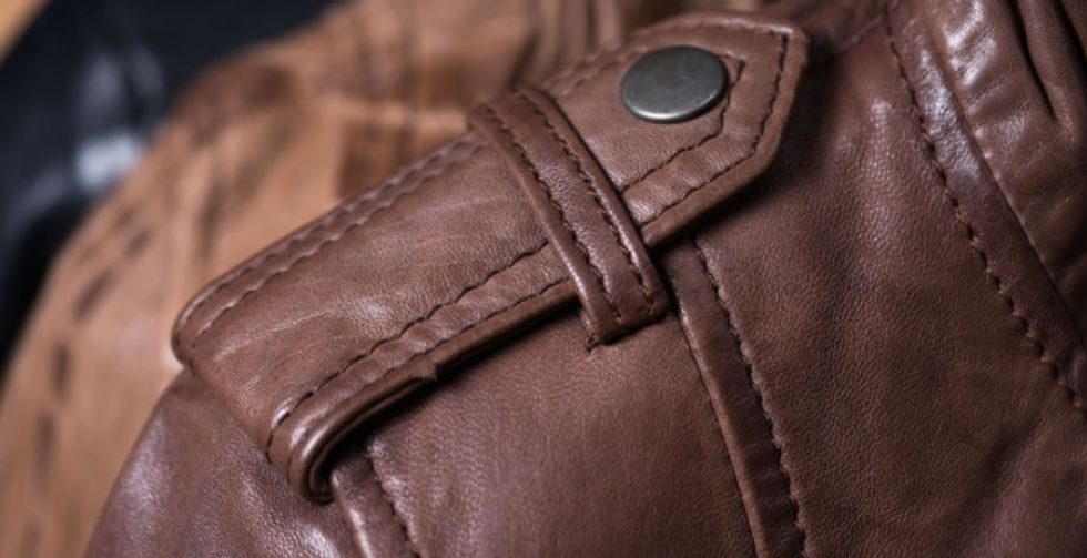 Woman discovers the shoulder button on jackets is for holding hand bags in place.