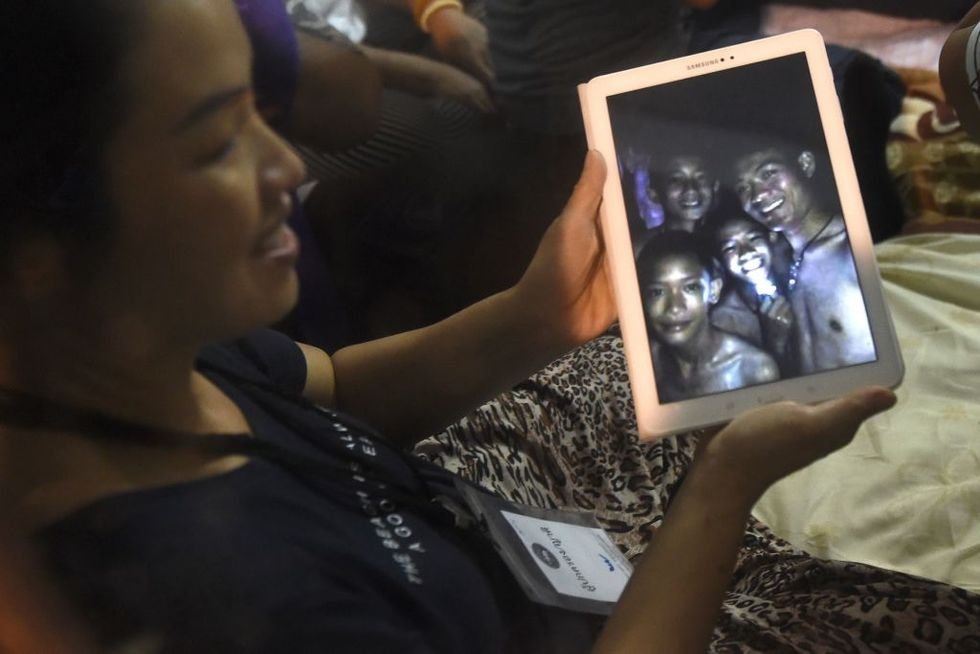 The coach of the trapped Thai soccer players is being called a hero for his selfless acts.