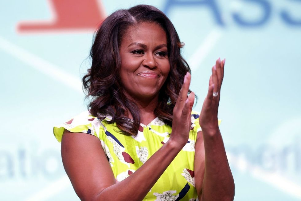Michelle Obama just paused her book tour to officiate this couple's wedding.