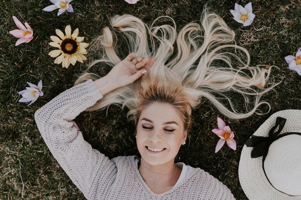 https://www.pexels.com/photo/woman-lying-on-flowers-1070967/
