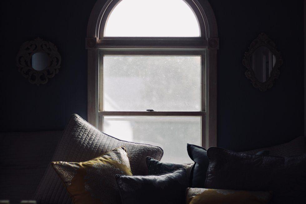 Throw pillows set against a bright window